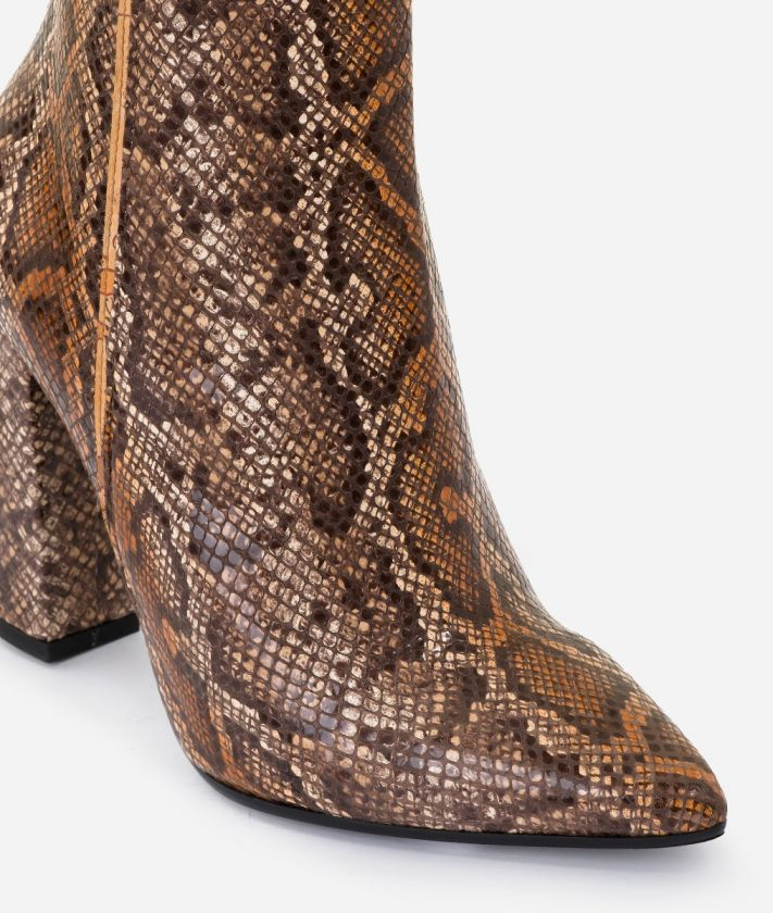 Ankle boots in leather with python print Brown